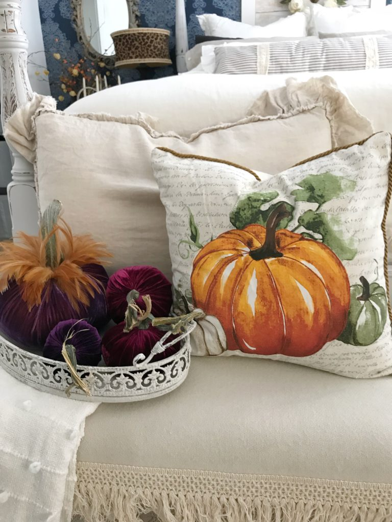 How to Decorate Bedrooms for Easy Fall Decor pumpkin pillow with ruffle linen pillow behind and 4 velvet pumpkins in white tray