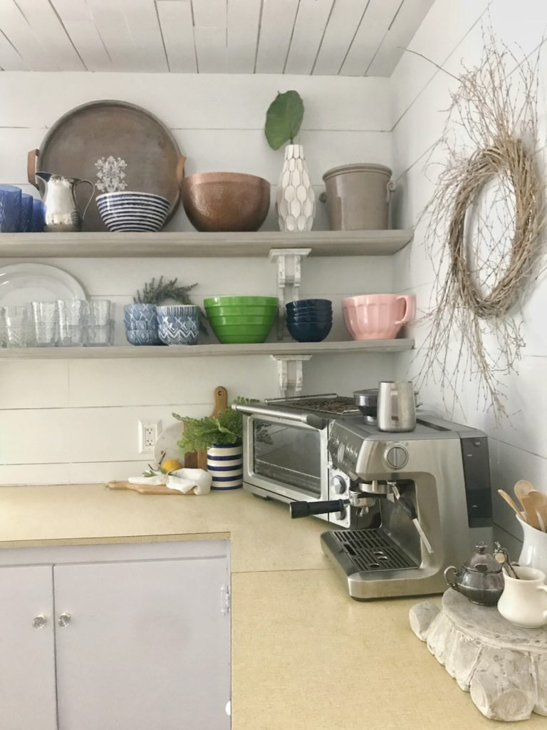 How to Organize Your Kitchen for Open Shelving with cups plates bowls