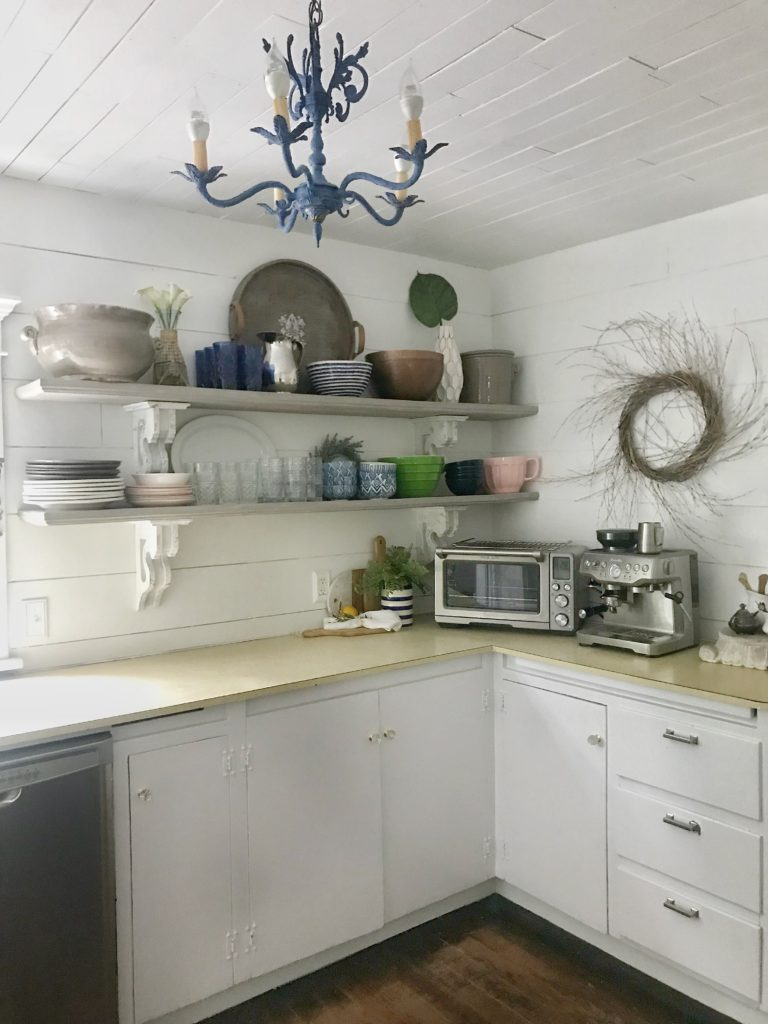 kitchen cabinets with uppers open shelving with plates and bowls