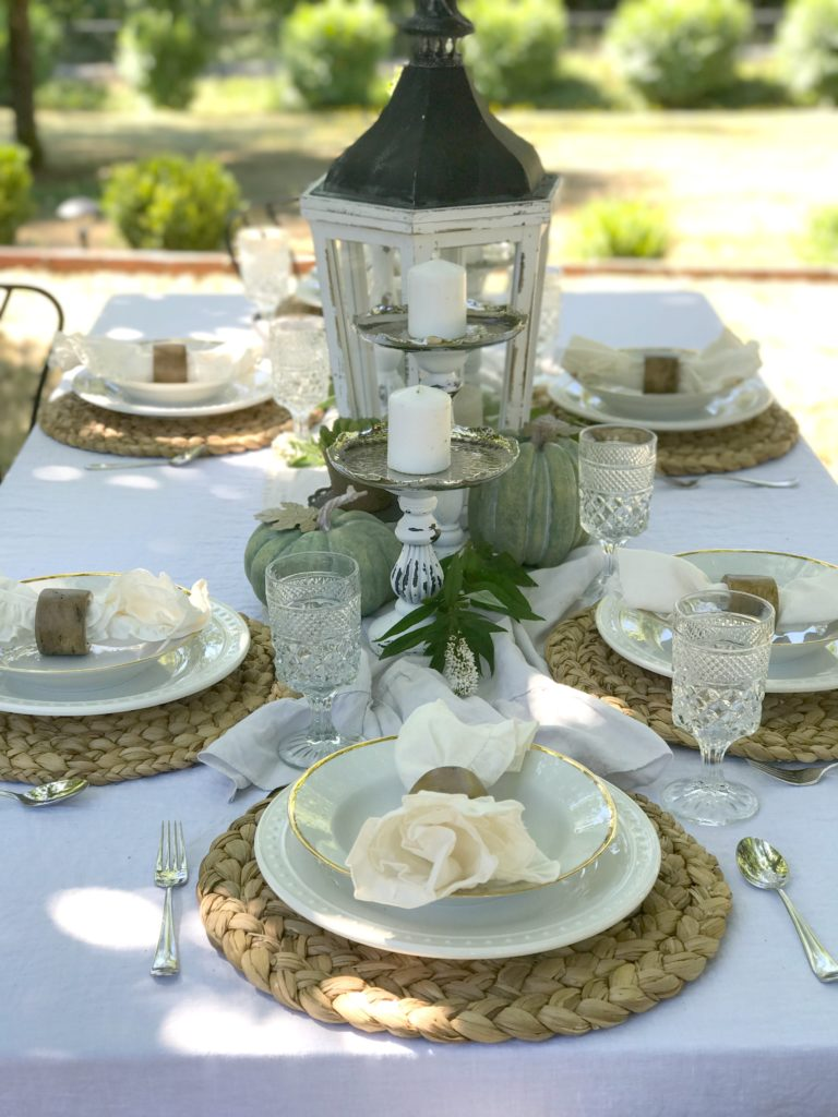 Simple and Easy Festive Fall Tablescapes 6 place settings with latern and green pumpkins in middle