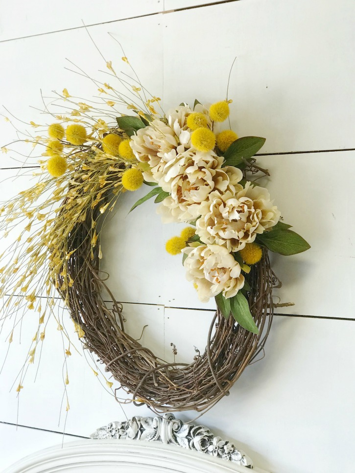 fall grapevine wreath with yellow and white flowers