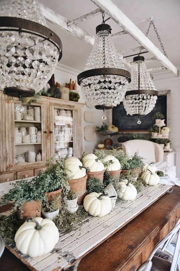 white pumpkins in pots in table centerpiece