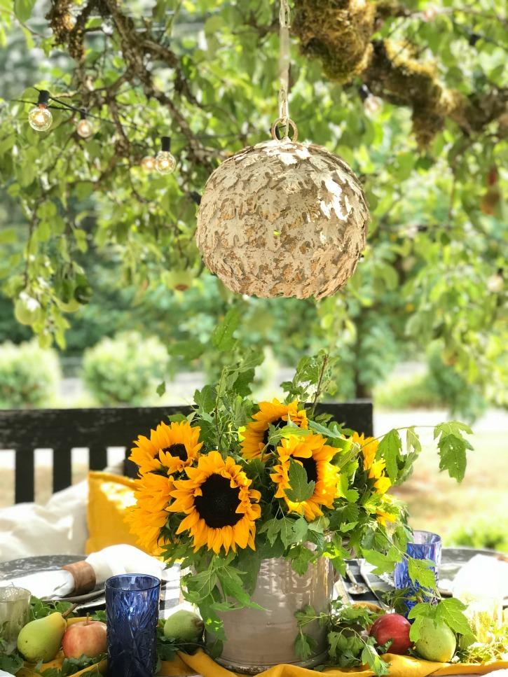 How to Decorate Your Fall Table in the Garden with bouquet of sunflowers and chandelier