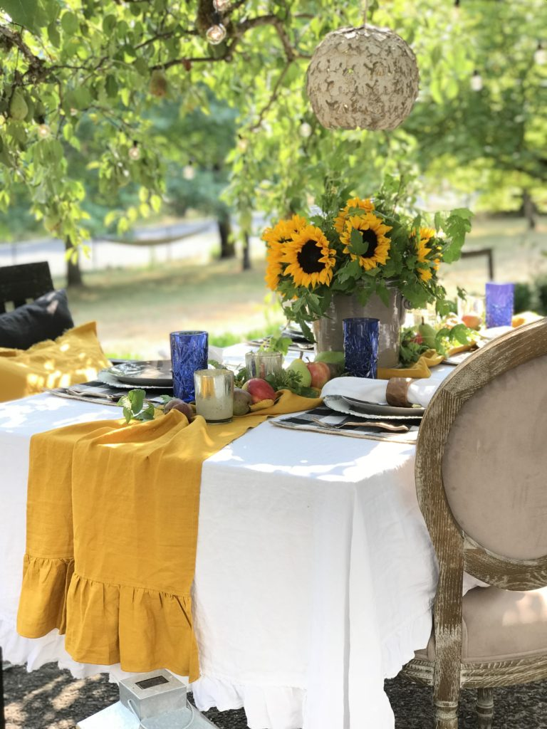 How to Decorate Your Fall Table in the Garden with yellow table runner and sunflower centerpiece
