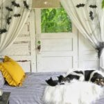stripe bed on napping porch with bats hanging on wall