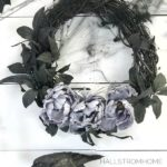 #1 Halloween Wreath that's Easy Elegant and Beautiful black wreath with purple flowers and black webs