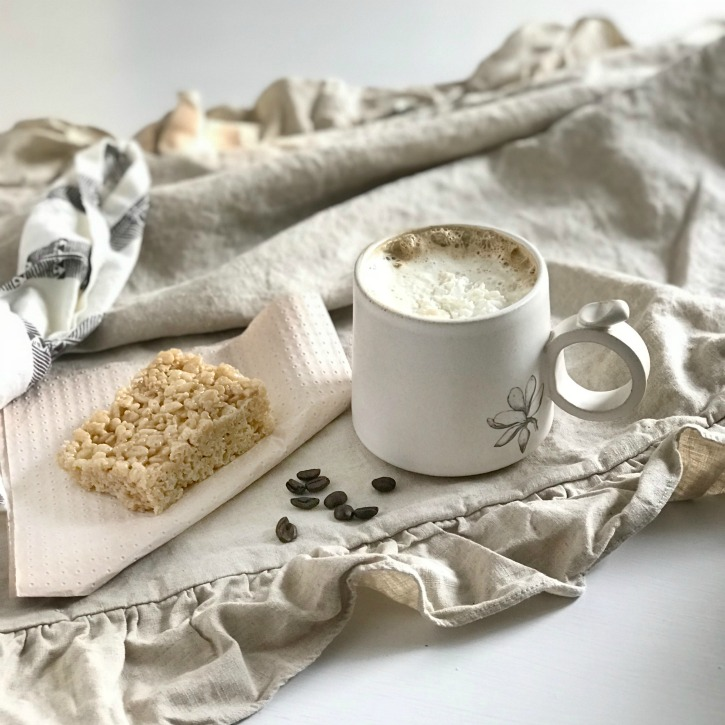 Amazing Salted Caramel Pumpkin Spice Latte Recipe with coffee and coffee beans on ruffle linen with knotted napkin