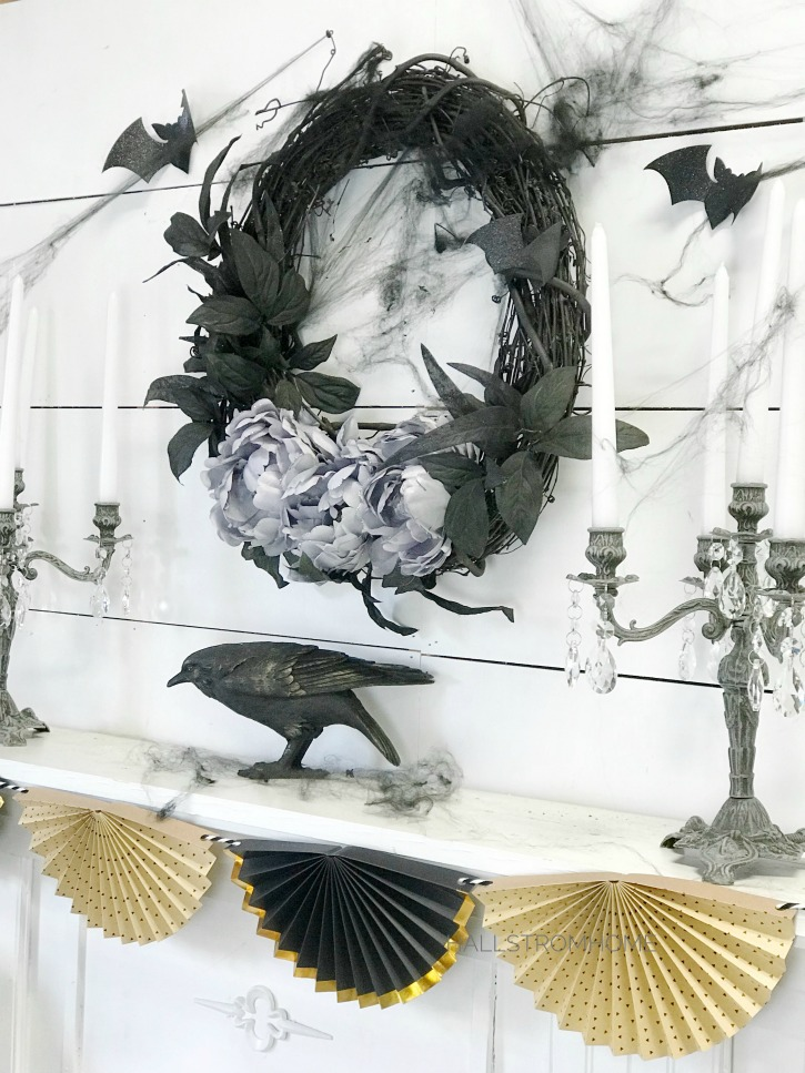 #1 Halloween Wreath that's Easy Elegant and Beautiful black wreath above mantel with crow and 2 candelabras with fan banner