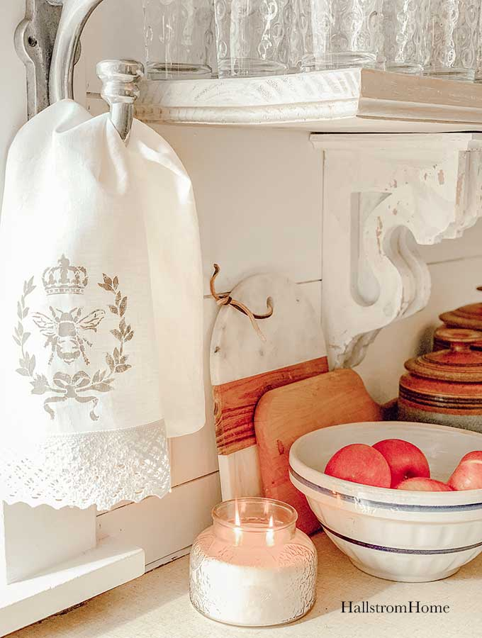How to Stencil Tea Towel Tutorial with Chalk Paint stenciled tea towel Vintage kitchen tea towels painted dish towels decorating tea towels how to stencil a tea towel farmhouse diy diy craft kids craft french cottage french bee stencil home decor shabby chic hallstrom home