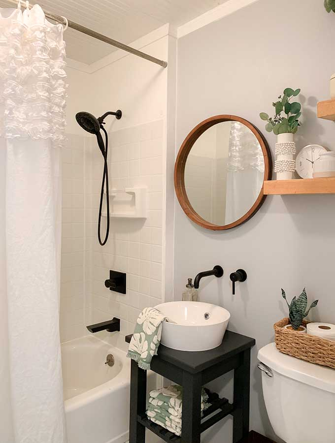 Small Bathroom Makeover Ideas|guest bathroom|powder room|paint color|bathroom makeovers|small bathroom makeover|small bathroom|storage space|bathroom remodels|before and after|pedestal sink|earth elements|bathroom faucet|delta faucets|sponsored|sink faucet|floor tiles|Hallstrom Home