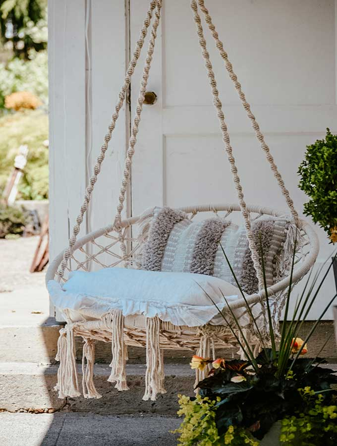 Hygge Porch Design with Swing |hygge life|hygge products|adding hygge|hygge chairs|hygge decor|simple porch designs|Scandinavian Porch|porch design ideas|boho porch|boho home|bohemian decor|Hallstrom Home