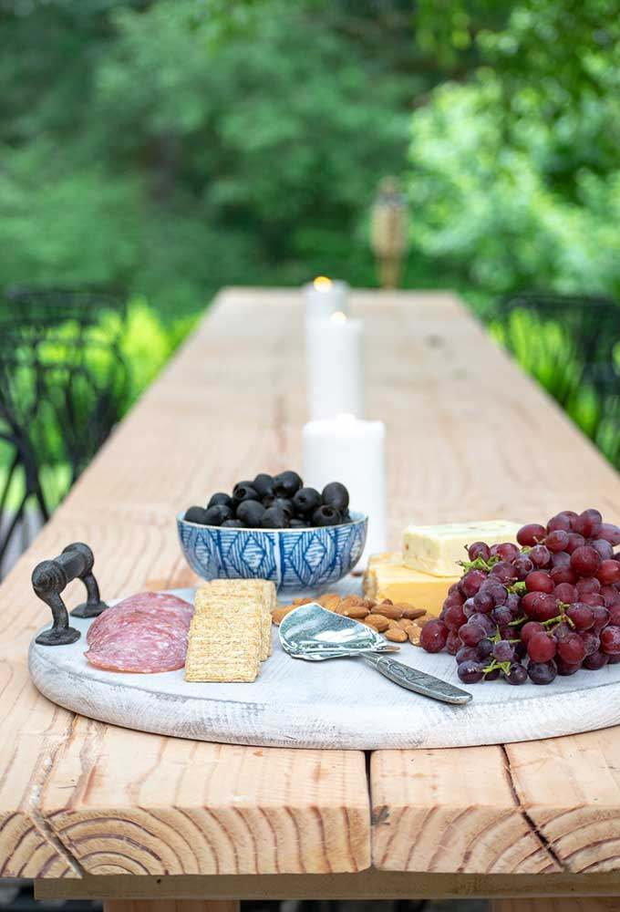 How to Use a Charcuterie Board for Entertaining|outdoor entertaining|how to assemble cheese board|cheese platter presentation|cheese platter appetizer|Farmhouse dining|outdoor dining|veranda|party planning|appetizer recipes|best recipes|party recipes|entertaining recipes|hallstrom home