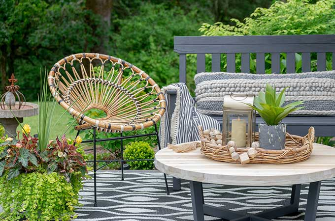 Sophisticated Bohemian Outdoor Setting|Article|Boho Patio|decorate bohemian|rattan furniture|patio update|outdoor entertaining| myarticle|boho home decor|sophisticated boho|scandinavian home|boho outdoor furniture|bohemian furniture|boho chic patio ideas|boho outdoor spaces|bohemian outdoor rug|Hallstrom Home