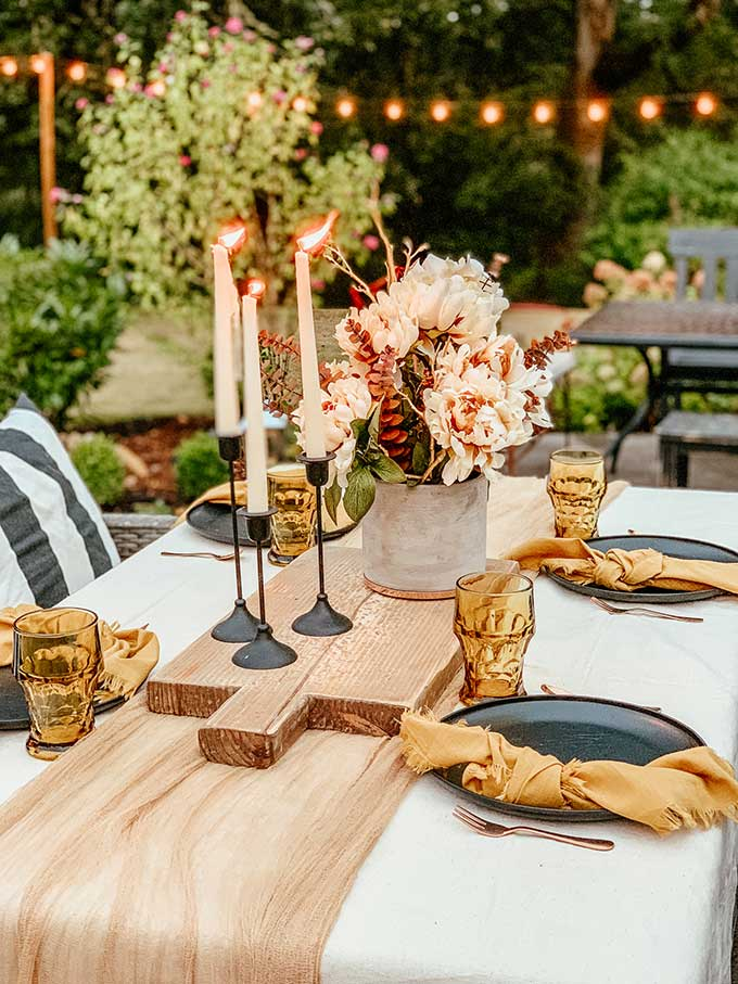 Easy Fall Outdoor Table with Drop Cloth |drop cloth tablecloth|diy tablecloth|fall outdoor table|farmhouse table|outdoor entertaining|farmhouse style|wedding table|wedding table setting|gauze table runner|cheesecloth table runner|simple fall decor|easy fall table|fall centerpiece|simple farmhouse table|pumpkin table setting|fall pumpkin table|cozy table setting|cozy fall|hygge home|Hallstrom Home