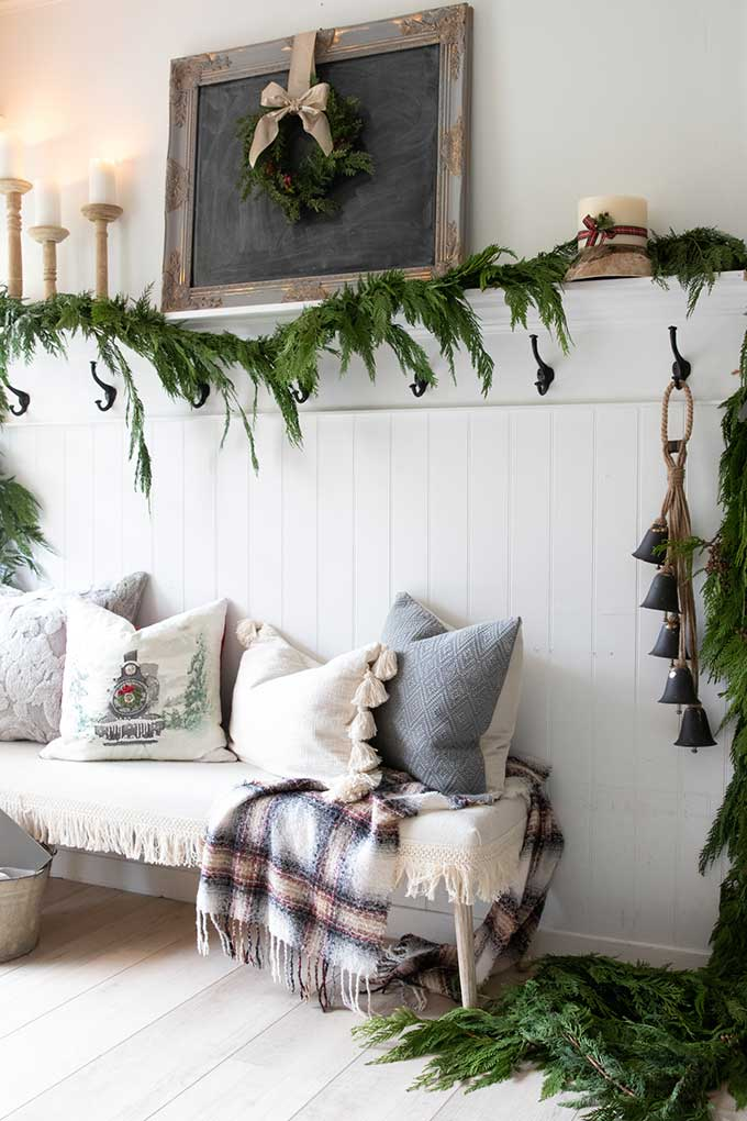Farmhouse Entry with Fresh Holiday Garland |Christmas decor|farmhouse Christmas|farmhouse entryway|white farmhouse|christmas garland|decorate for christmas|shabby chic home|shabby chic decor|farmhouse style|christmas chalk board|christmas wreath|christmas garland|Hallstrom home