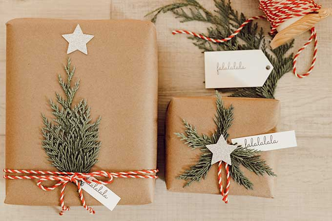Natural Holiday Gift Wrap with Greenery |simple christmas wrapping|scandinavian Christmas|scandinavian christmas wrapping|christmas tree wrapping paper|best Christmas wrap ideas|cedar gift wrap|free printables|christmas gift tags|christmas printables|easy gift wrap ideas|farmhouse christmas|white farmhouse|easy gift diy|Hallstrom Home