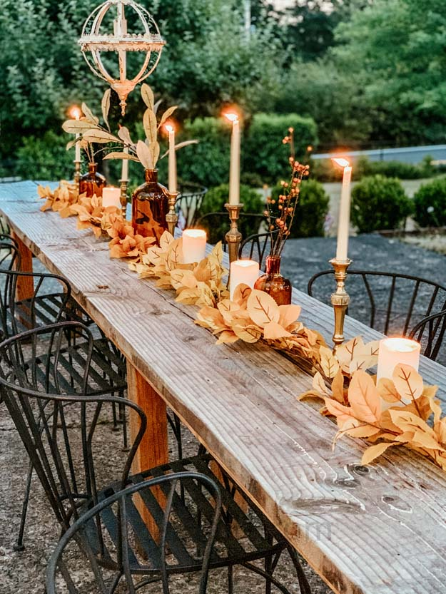 Outdoor Fall Tablescape with Leaves |fall table settings|farmhouse table|fall farmhouse table|farmhouse decor|fall leaves|fall leaf diy|outdoor tablescape|fall table settings|amber jars|fall centerpiece|amber fall decor|fall diy|fall craft|Hallstrom Home